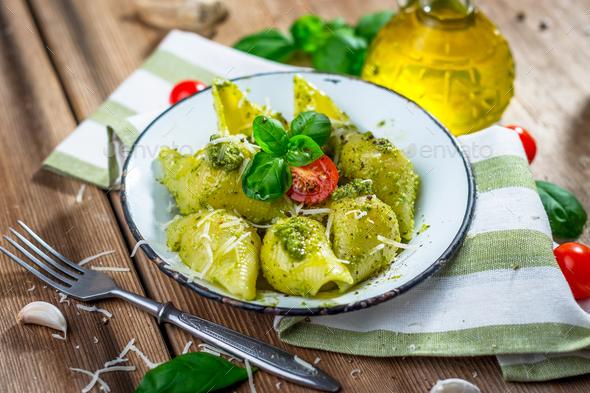 Pasta conchiglie con pesto genovese - Stock Photo - Images
