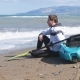A Young Man with a Kayak on the Seashore - VideoHive Item for Sale