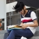 Asian Student Man Sitting on Stairs and Reading Books - VideoHive Item for Sale