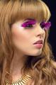 Beauty portrait with pink false eyelashes