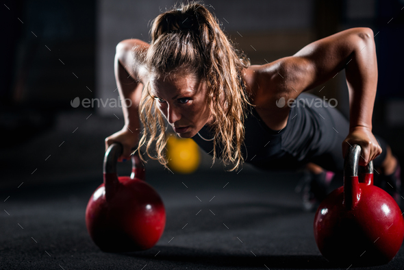 Woman athlete exercising with kettlebell - Stock Photo - Images