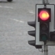 Red Traffic Light Lights up Against a Background of Moving Cars on a City Road - VideoHive Item for Sale