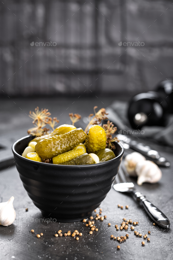Pickled cucumbers, small marinated pickles, gherkins - Stock Photo - Images