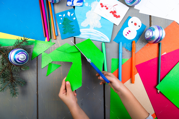 Child hands make handmade christmas toys from cardboard. Children's DIY concept. - Stock Photo - Images