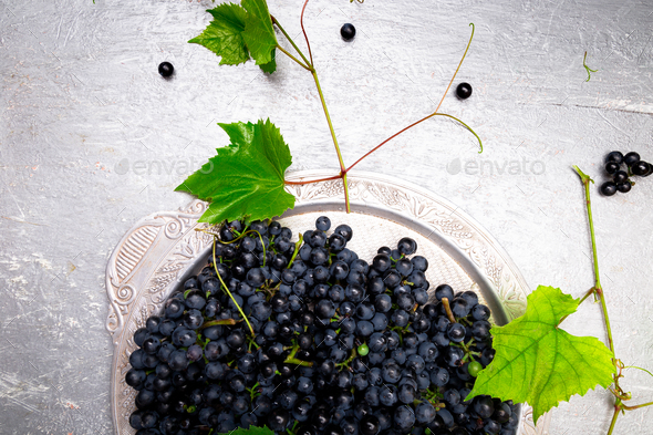 Red wine grapes in silver tray on grey background. Top view. Copy space. - Stock Photo - Images