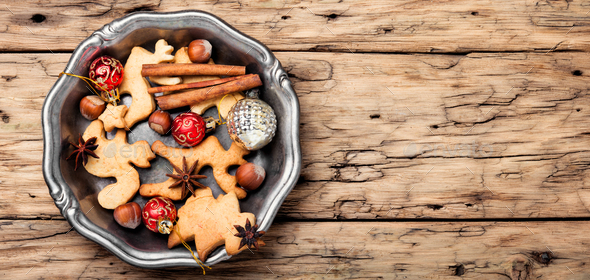 Christmas cookie on retro wooden background - Stock Photo - Images