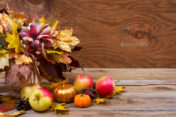 Thanksgiving table centerpiece with fall leaves bouquet - Stock Photo - Images