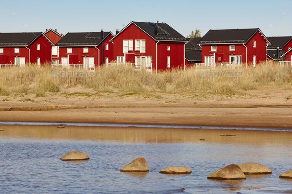 Red wooden houses near Marjaniemi beach, Hailuoto island. Finland. Travel - Stock Photo - Images