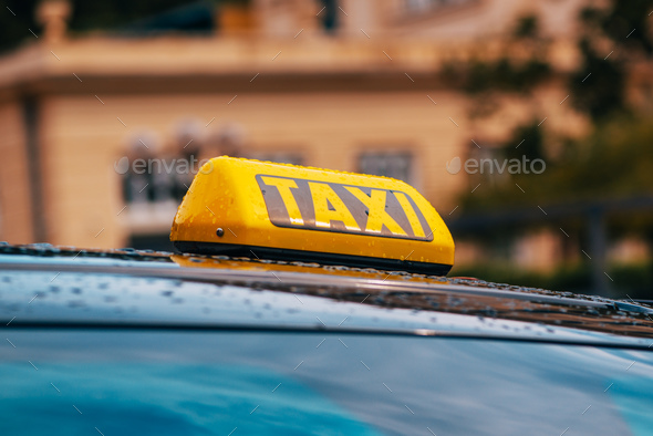 Yellow taxi sign on car roof - Stock Photo - Images