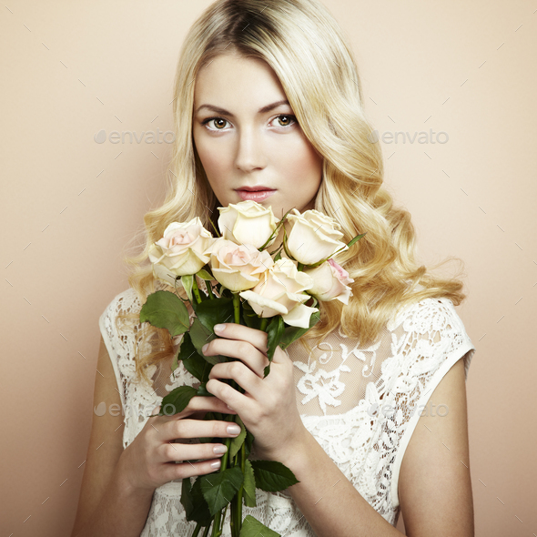Portrait of a beautiful blonde woman with flowers - Stock Photo - Images