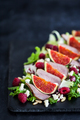 Delicious salad with fresh figs, raspberry and duck meat
