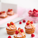 Raspberry and caramel cupcakes on white background - PhotoDune Item for Sale