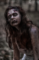 Zombie woman with wounds