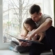 Father and Daughter Reading a Book - VideoHive Item for Sale