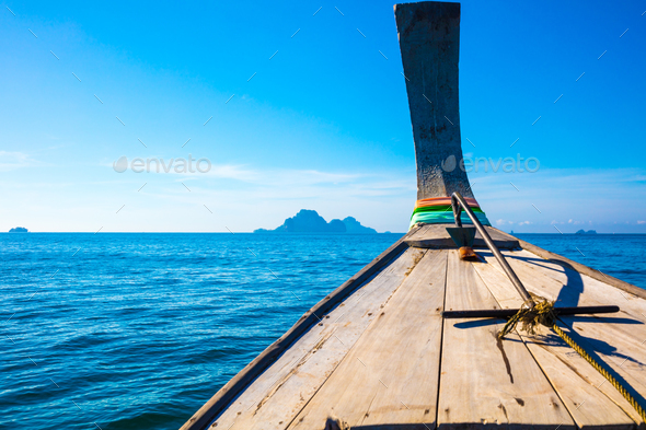 Longtail Boat In Sea At Aonang Beach Against Blue Sky - Stock Photo - Images