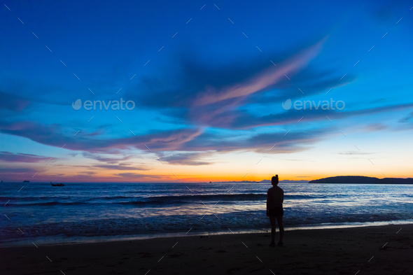 Silhouette Female Standing At Beach During Sunset - Stock Photo - Images