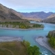 Aerial Footage of a Blue River Running in a Mountain Valley - VideoHive Item for Sale