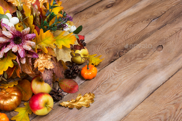 Rustic fall background with golden pumpkin and oak leaves - Stock Photo - Images