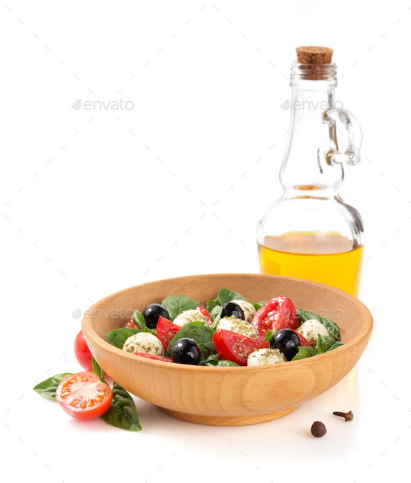 caprese salad in plate on white background - Stock Photo - Images
