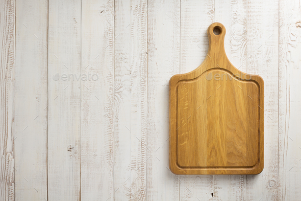 cutting board at wooden background - Stock Photo - Images