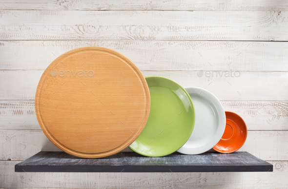 plate at shelf on white wooden background - Stock Photo - Images