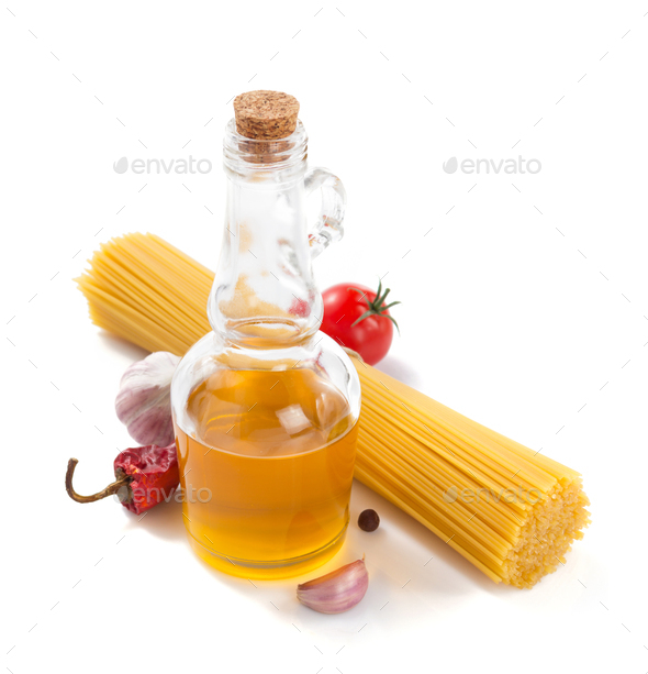 bottle of oil isolated and spices at white - Stock Photo - Images