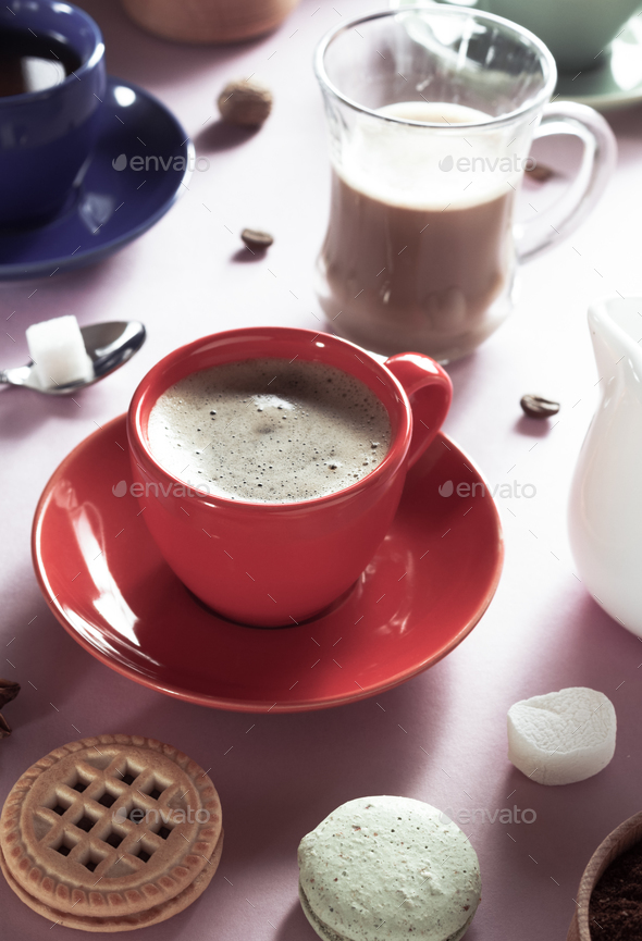 cup of coffee, tea and cacao at purple background - Stock Photo - Images
