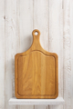 cutting board at shelf at wooden background - PhotoDune Item for Sale
