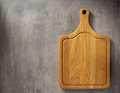 cutting board at grey stone table - PhotoDune Item for Sale