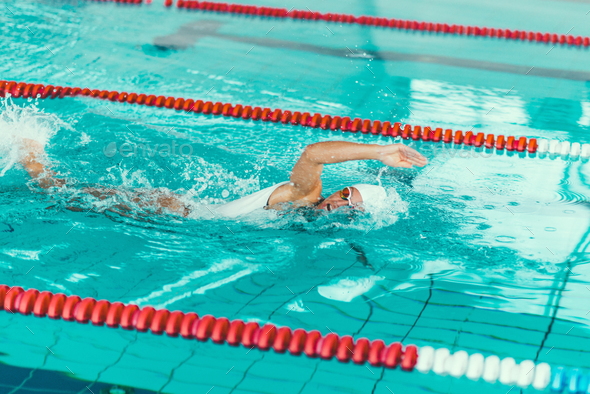 Female swimmer on training in the swimming pool - Stock Photo - Images