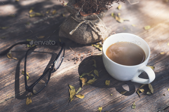 Glasses with cup of coffee on wooden table - Stock Photo - Images