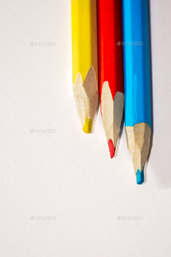 Colorful crayons on white paper - Stock Photo - Images