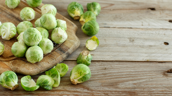 Brussels sprouts on a wooden board - Stock Photo - Images