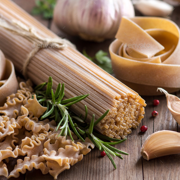 Whole wheat italian pasta with garlic and herbs - Stock Photo - Images