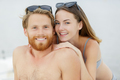couple smiling on the beach on a sunny day - PhotoDune Item for Sale