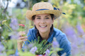 happy smiling young woman with flowers at garden - PhotoDune Item for Sale