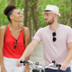man with a bike woman standing next to him - PhotoDune Item for Sale