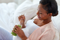 pregnant woman drinking vegetable juice in bed