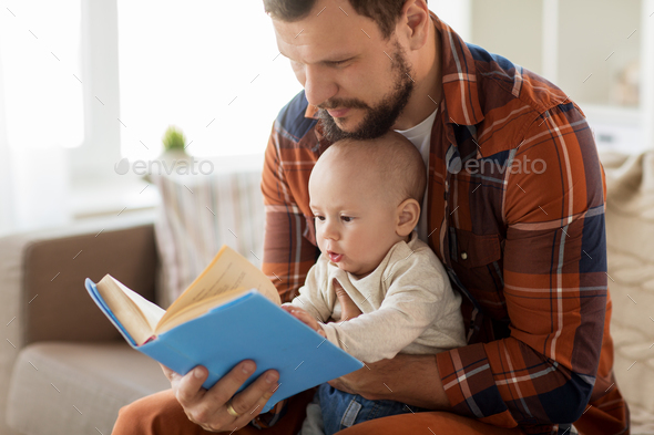 happy father and little baby boy with book at home - Stock Photo - Images
