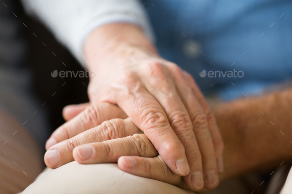 close up of senior couple holding hands - Stock Photo - Images