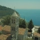 Arial View. Catholic Cathedral in Small Town, a Church of White Stone on the Seashore Summer - VideoHive Item for Sale