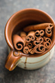 Cinnamon sticks in cup. - PhotoDune Item for Sale
