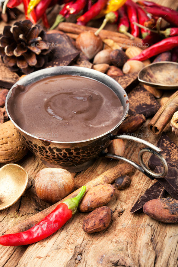 Melting chocolate,spice and nuts - Stock Photo - Images