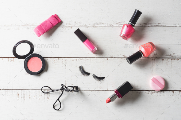 Various make-up products and cosmetics on wooden table - Stock Photo - Images