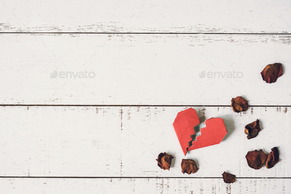 Red broken heart with dried rose petal - Stock Photo - Images