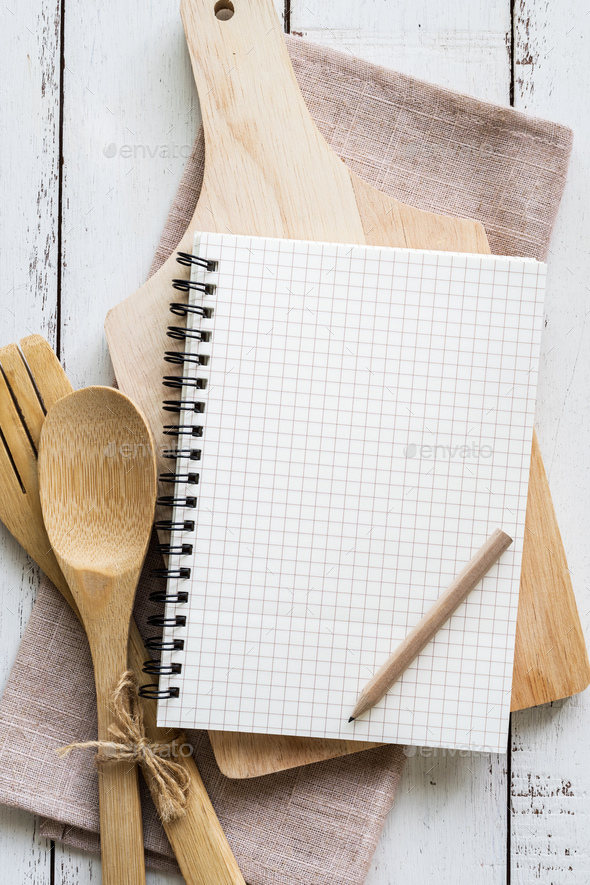 Blank notebook with wooden utensil - Stock Photo - Images