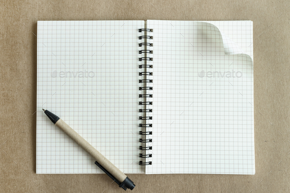 Blank notebook with pen on brown background - Stock Photo - Images