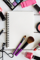 Blank notebook with Various makeup products and cosmetics
