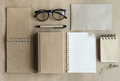 Recycle notebook with notepaper on desk office, Top view