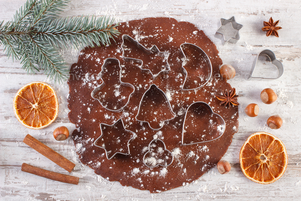 Dough for Christmas cookies, spice and ingredient for baking gingerbread on rustic plank - Stock Photo - Images